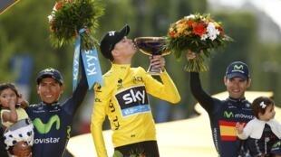 Britain's Chris Froome (centre),celebrates his 2015 Tour de France win.