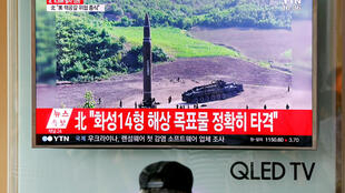 A man watches a TV broadcasting still photographs released by North Korea's state-run television KRT of North Korea's Hwasong-14 missile, a new intercontinental ballistic missile, which they said was successfully tested, at a railway station in Seoul, Sout