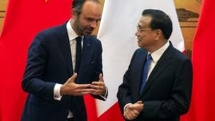 French Prime Minister Edouard Philippe speaks to China's Premier Li Keqiang during a signing ceremony at the Great Hall of the People in Beijing, China June 25, 2018.