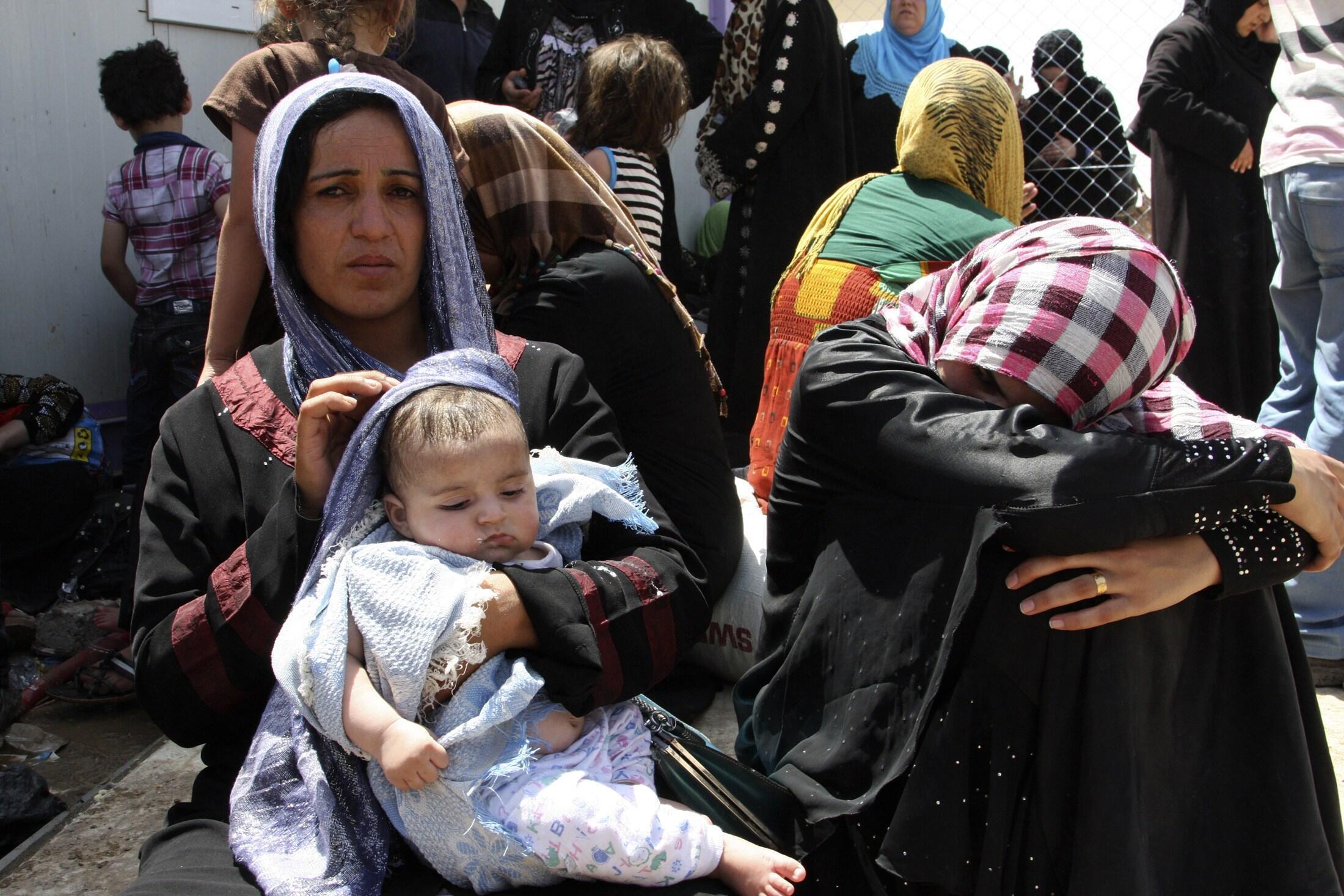 Беженцы из города Мосул на севере Ирака. 20 июня 2014