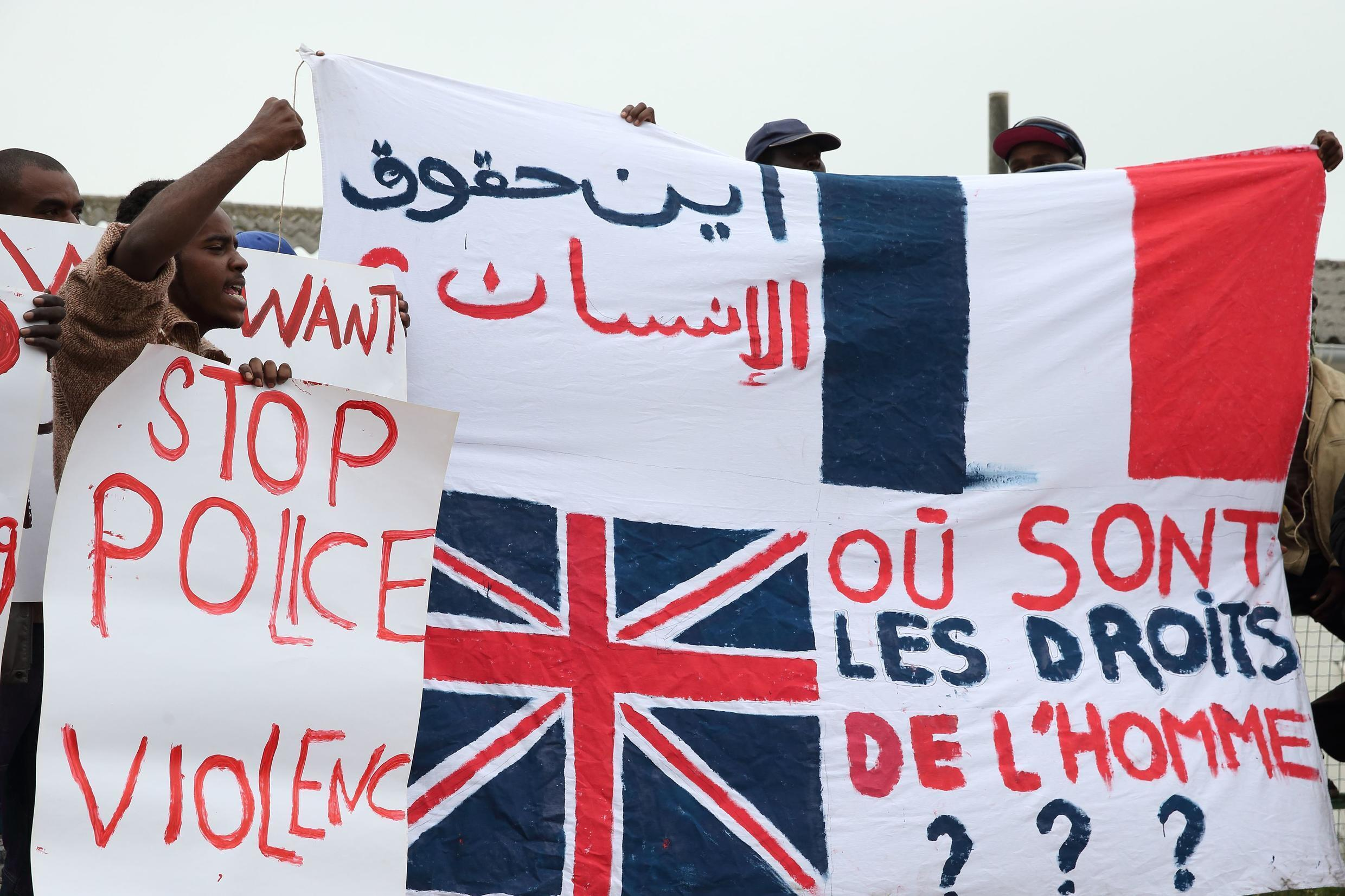 Migrants from Africa demonstrate in front of the Calais town hall earlier this month