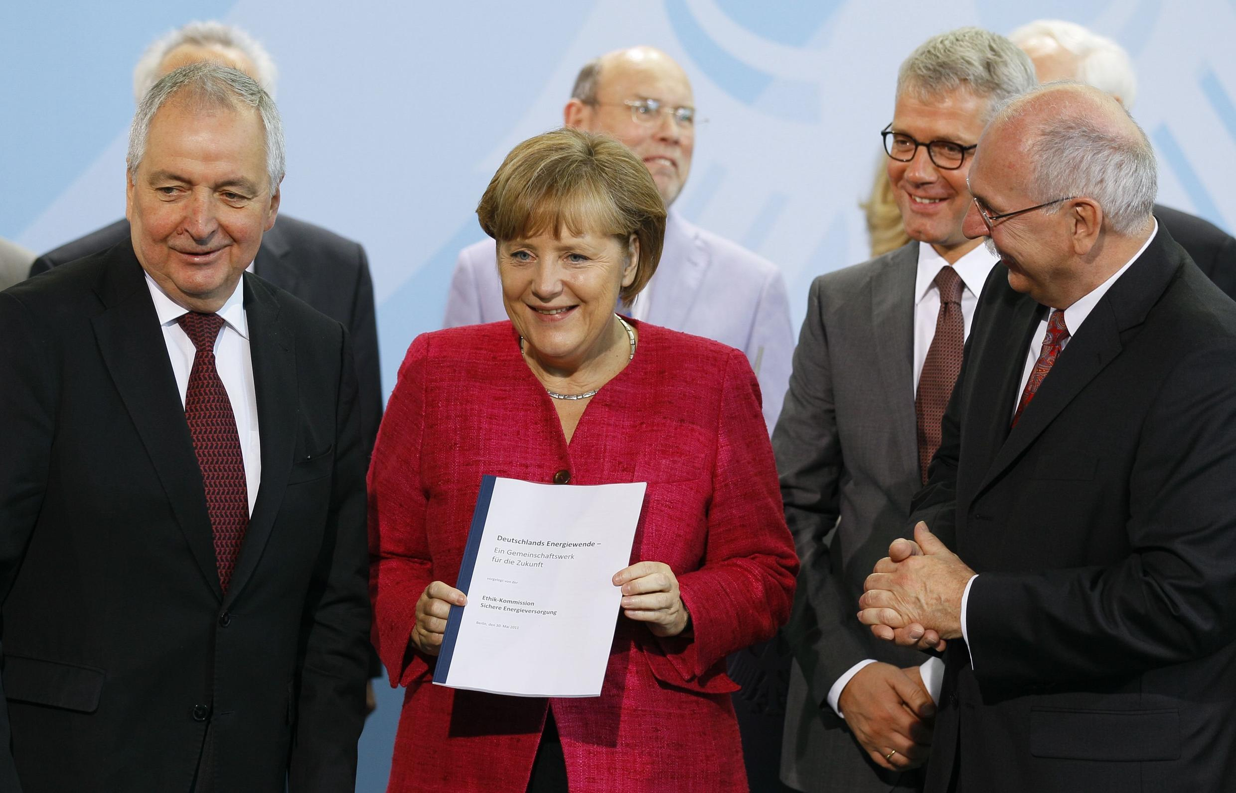 German Chancellor Angela Merkel receives the report of the so-called Ethics Commission for a Secure Energy Supply, Berlin 30 May 2011