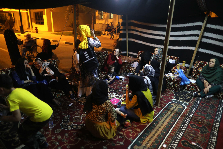 Refugiados do Afeganistão à chegada a Doha.