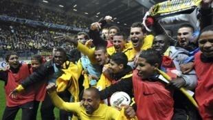 Jogadores do Quevilly celebram a vitória contra Rennes, nesta quarta-feira em Caen.