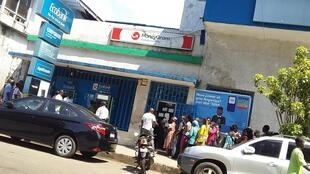People queueing for cash outside a bank in Monrovia.