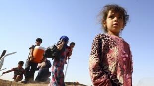 2014年7月17日,伊拉克难民营里的幼童。