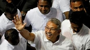 Sri Lanka's former defense secretary Gotabaya Rajapaksa waves after he was nominated as a presidential candidate during the Sri Lanka People's Front party convention in Colombo, Sri Lanka, 11 August, 2019.