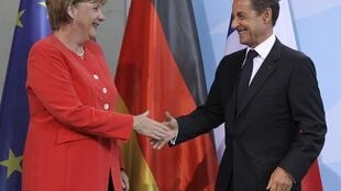 លោកស្រីប្រមុខរដ្ឋាភិបាលអាល្លឺម៉ង់ Angela Merkel និងលោកប្រធានាធិបតីបារាំង Nicolas Sarkozy ថ្ងៃទី១៧មិថុនា ២០១១