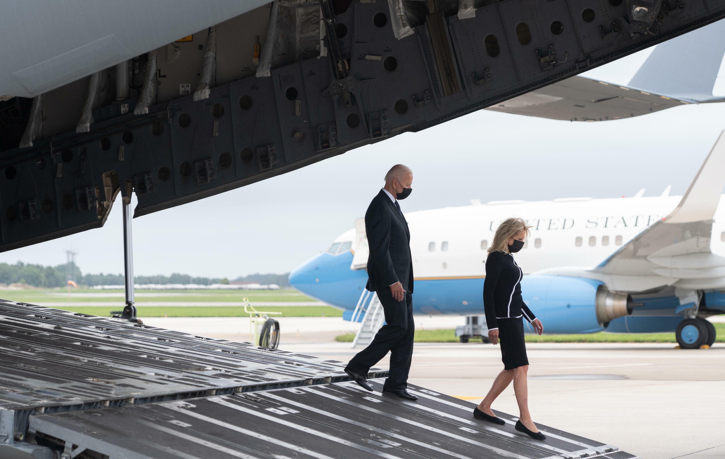US President Joe Biden and First Lady Jill Biden walk off a military airplane following a prayer after the last American service members killed in Afghanistan were flown home