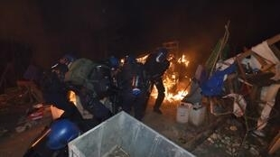 This handout photo released by the French Gendarmerie Nationale shows an operation by French gendarmes to evacuate opponents of a nuclear waste burial site in the Lejuc woods in Bure early on February 22, 2018.