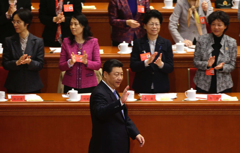 中国国家主席习近平2013年10月28日在北京人大会堂出席第11届全国妇女代表大会开幕式。