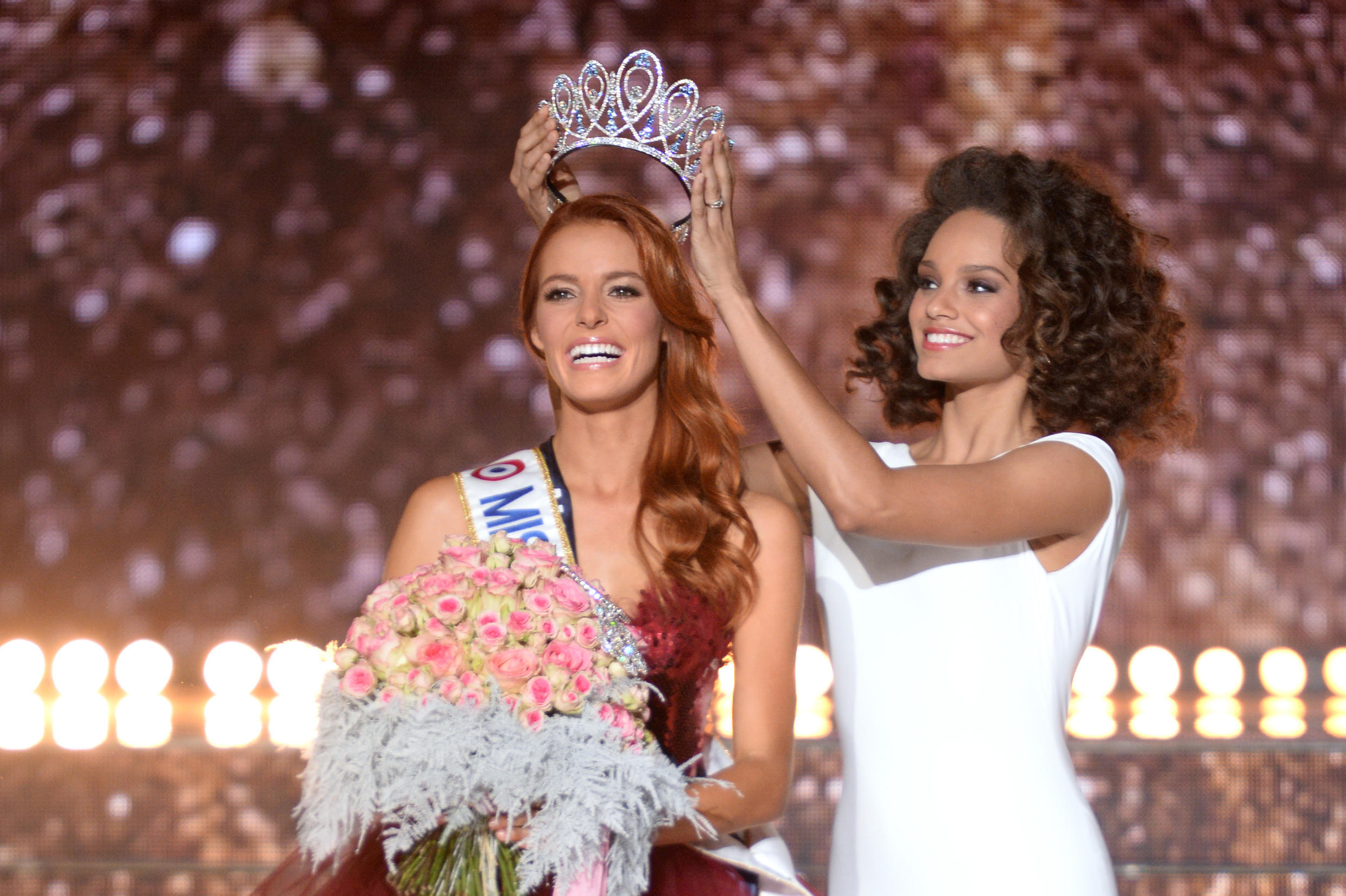 Miss France 2018 Maeva Coucke (L) is crowned by Miss France 2017 Alicia Aylies after winning the pageant in Chateauroux, central France, on December 16, 2017.