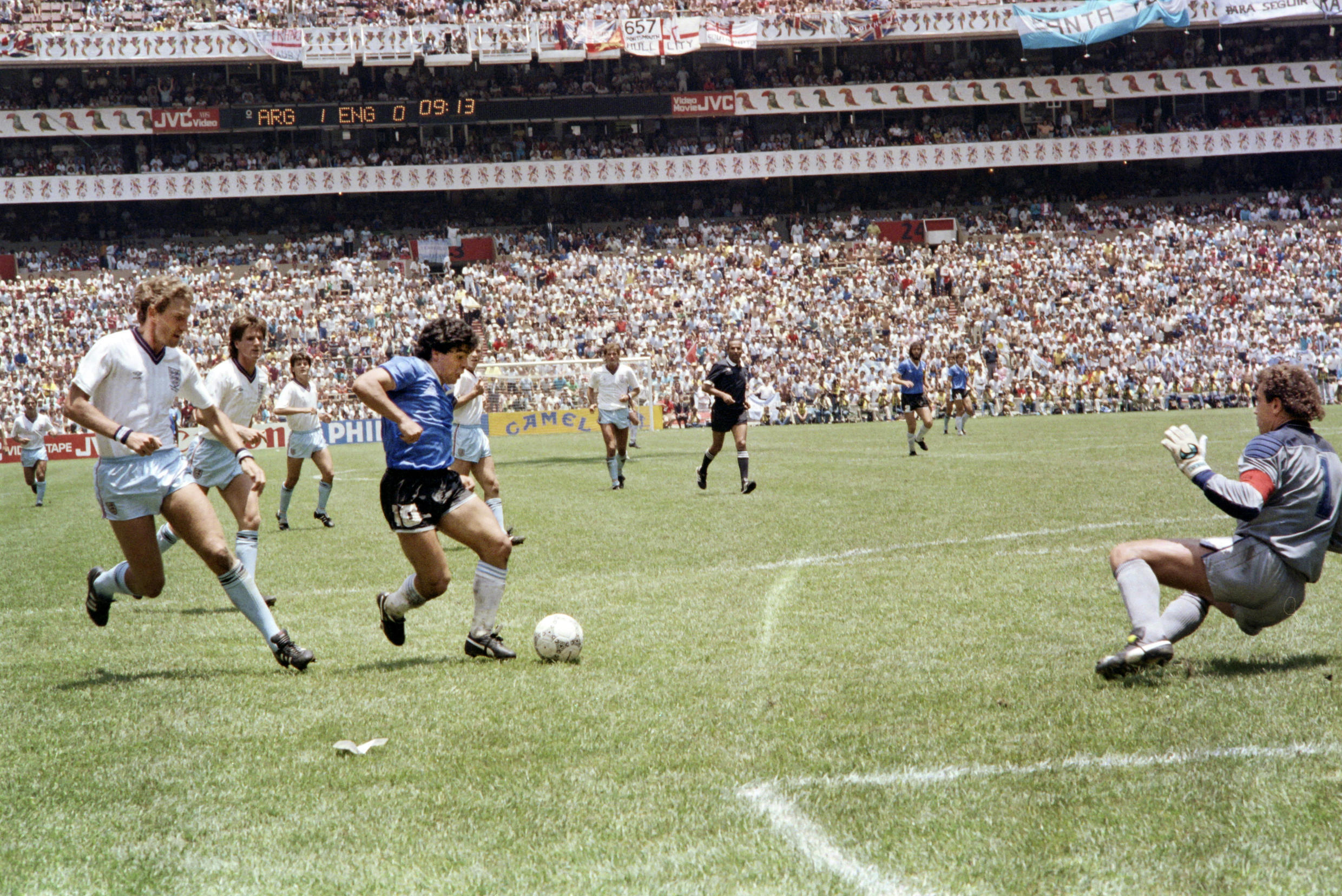 (FILE) Photograph taken on June 22, 1986 in Mexico City. The Argentine star Diego Maradona marks the so-called Goal of the Century for England playing for Argentina in the Mexico-1986 World Cup