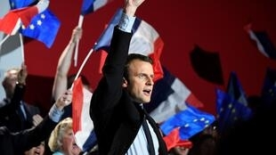 This file photo taken on April 26, 2017 in Arras shows French presidential election candidate for the En Marche ! movement Emmanuel Macron reacting as he gives a speech during a meeting ahead of the second and final round of the presidential election.