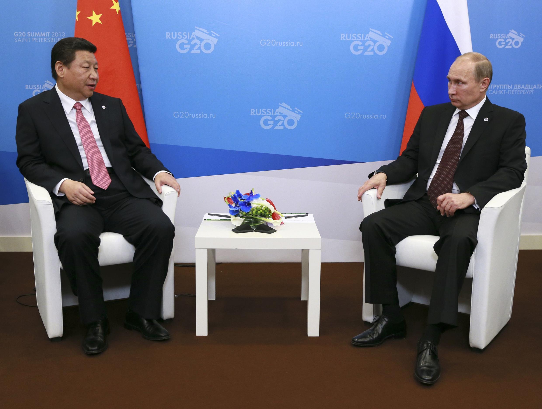 Les dirigeants chinois et russe, Xi Jinping et Vladimir Poutine, le 5 septembre 2013.