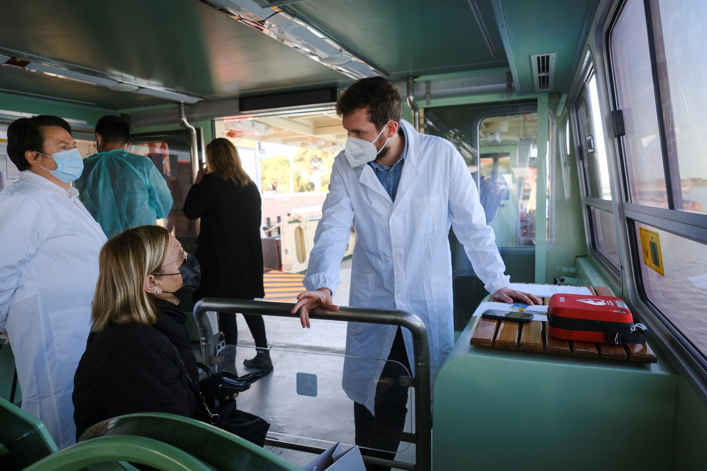 A Venice resident waits for an injection of a coronavirus disease (COVID-19) vaccine on board a traditional 'vaporetto', a ferry normally used for public transportation in Venice, Italy, April 5, 2021.