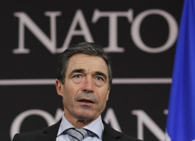 Nato Secretary-General Anders Fogh Rasmussen addresses the Lisbon summit