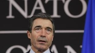 Nato Secretary-General Anders Fogh Rasmussen addresses the Lisbon summit