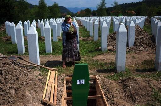 A Bosnian woman mark the 15th anniversary of the Srebrenica massacre last year