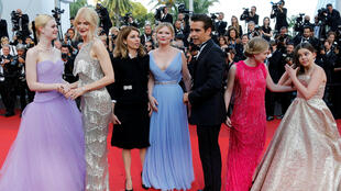 On the red carpet at Cannes, 24th May 2017, Sofia Coppola in black surrounded by the cast of The Beguiled from (L) Elle Fanning, Nicole Kidman, Kirsten Dunst, Colin Farrell, Angourie Rice and Addison Riecke
