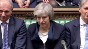 Theresa May durante o voto dos parlamentares sobre o acordo do Brexito, rejeitado por uma ampla maioria.