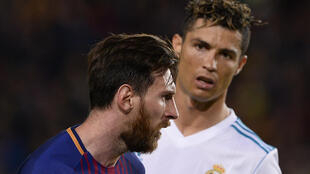 Lionel Messi (left) and Cristiano Ronaldo were adversaries in Spain for a decade.