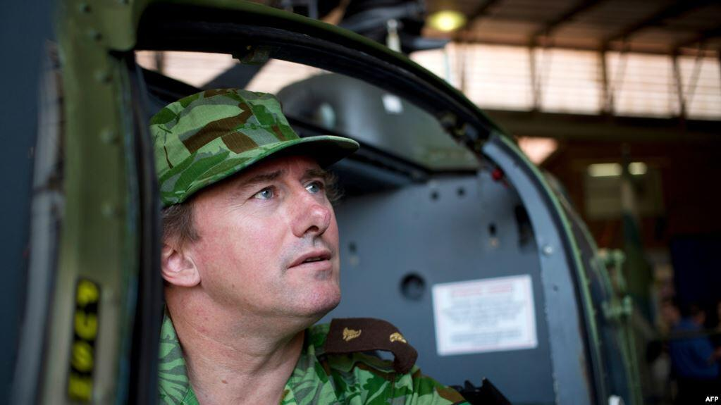 Gabon's new Forestry Minister Lee White, sitting in a helicopter during anti poaching mission