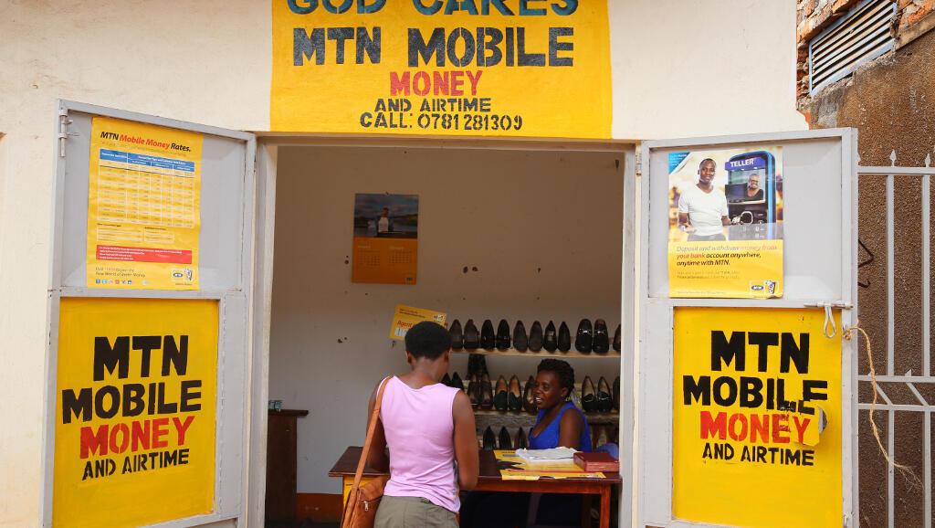 Une cabine de «mobile money» en Ouganda.