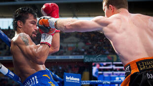 Manny Pacquiao (L) of the Philippines fight Jeff Horn (R) of Australia during the World Boxing Organization boat at Suncorp Stadium in Brisbane on July 2, 2017.