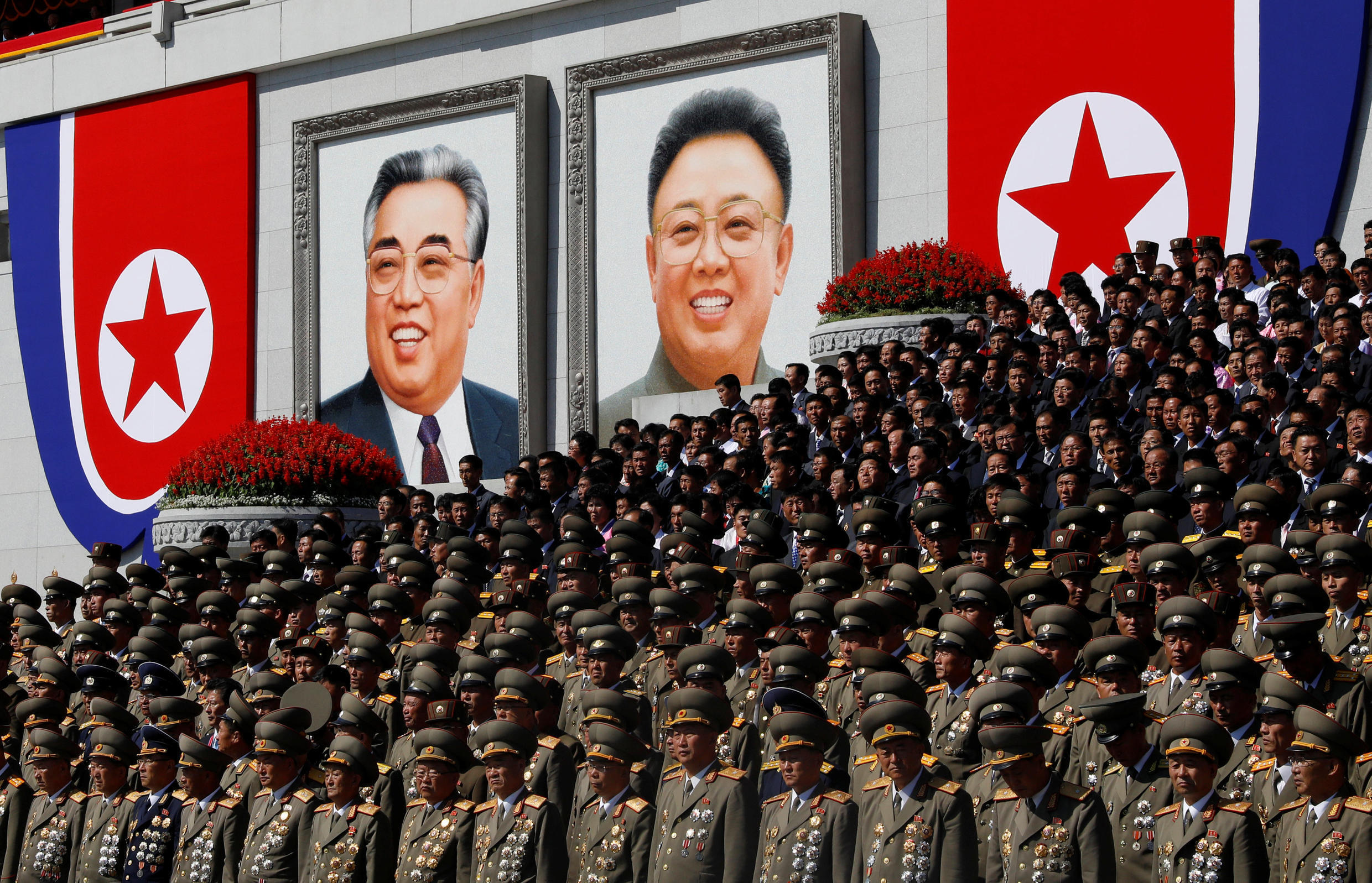 Senior military officials watch a parade as portraits of late North Korean leaders Kim Il Sung and Kim Jong Il are seen in the background at the main Kim Il Sung square in Pyongyang, North Korea, September 9, 2018.
