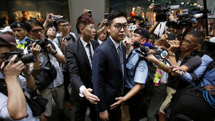 Andy Chan, a founder of the Hong Kong National Party, is surrounded by photographers as he leaves the Foreign Correspondents' Club in Hong Kong, China August 14, 2018.
