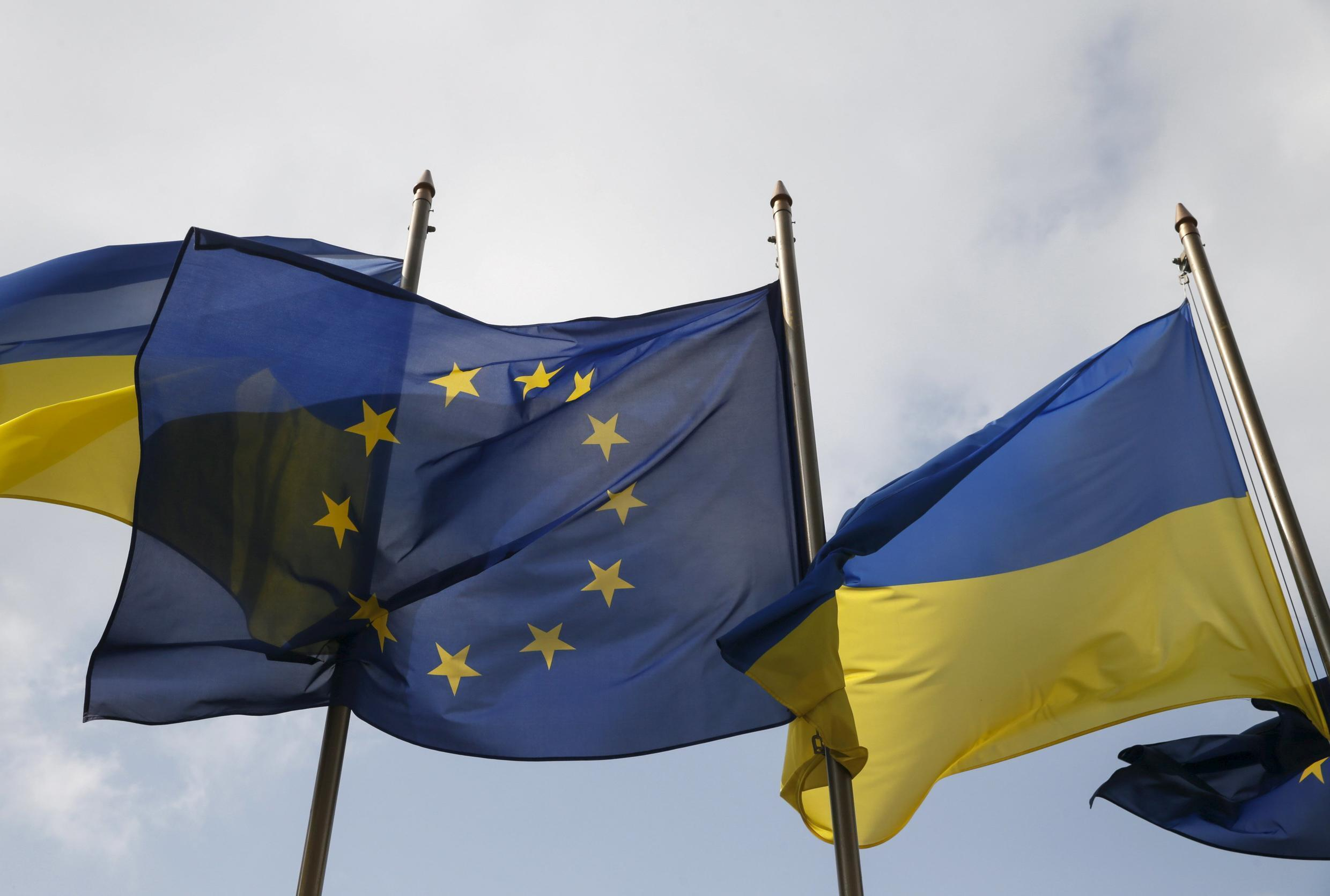 Ukrainian and EU flags fly in front of the Presidential Administration in Kiev, Ukraine, April 7, 2016.
