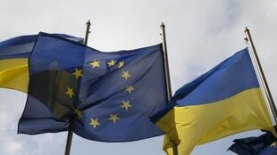 Ukrainian and EU flags fly in front of the Presidential Administration in Kiev