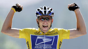 File Photo: U.S. Postal Service Team rider Lance Armstrong of the United States raises his arms as he crosses the finish line to win the 204.5 km long 17th stage of the Tour de France from Bourd-d'Oisans to Le Grand Bornand, France, July 22, 2004