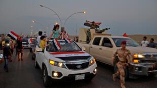 Le peuple irakien célèbre la reconquête Mossoul, le 9 juillet 2017.