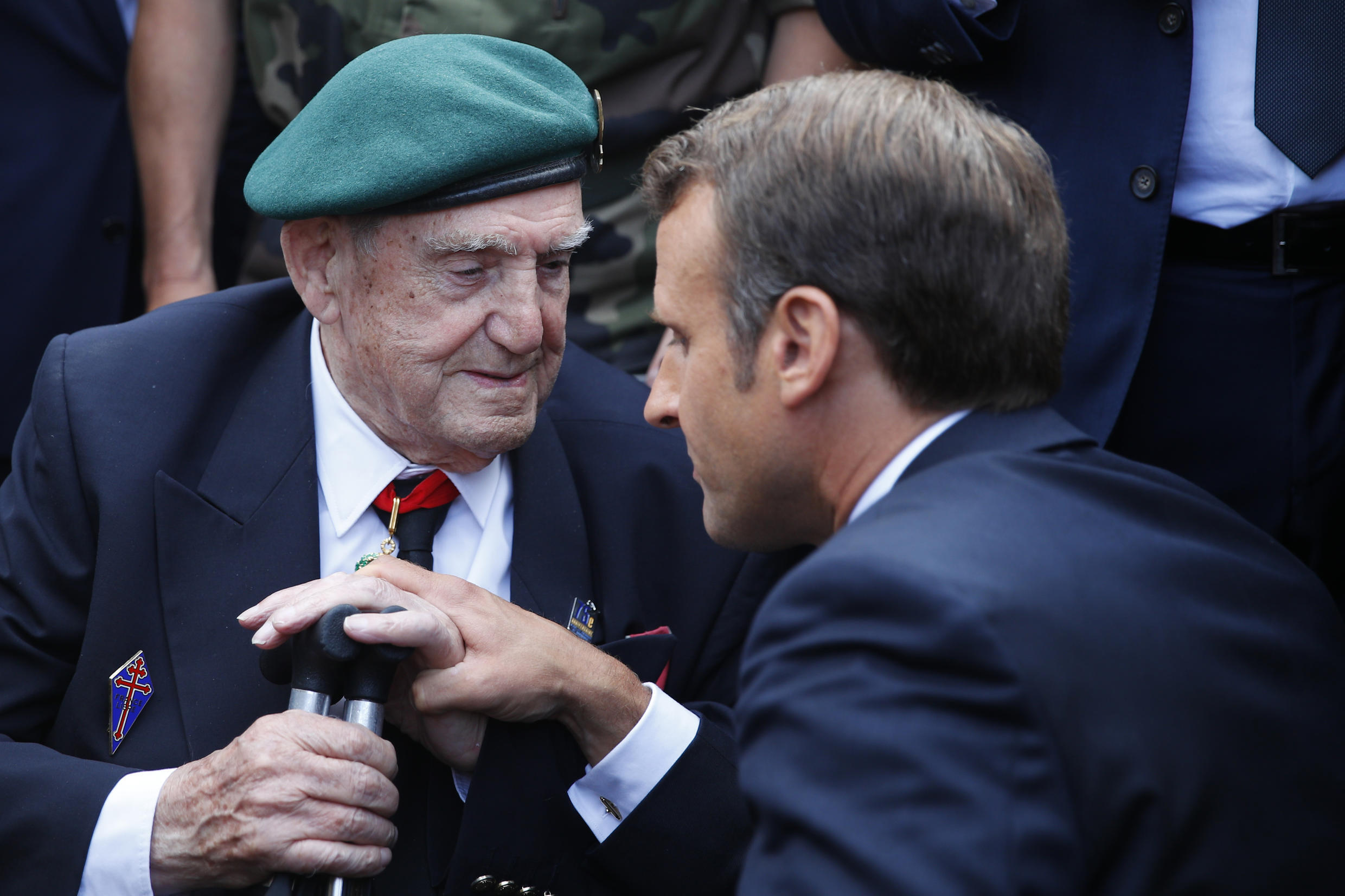 President Macron talks to Leon Gautier during a ceremony to pay homage to the Kieffer commando, Thursday, June 6, 2019 in Colleville-Montgomery, Normandy. The Kieffer commando, an elite French unit, was among the first waves of Allied troops to storm the heavily defended beaches of Nazi-occupied northern France, beginning the liberation of western Europe.