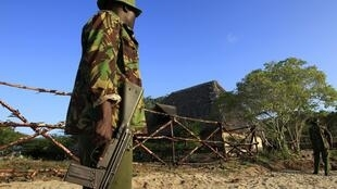 A Kenyan soldier outside Dedieu's house