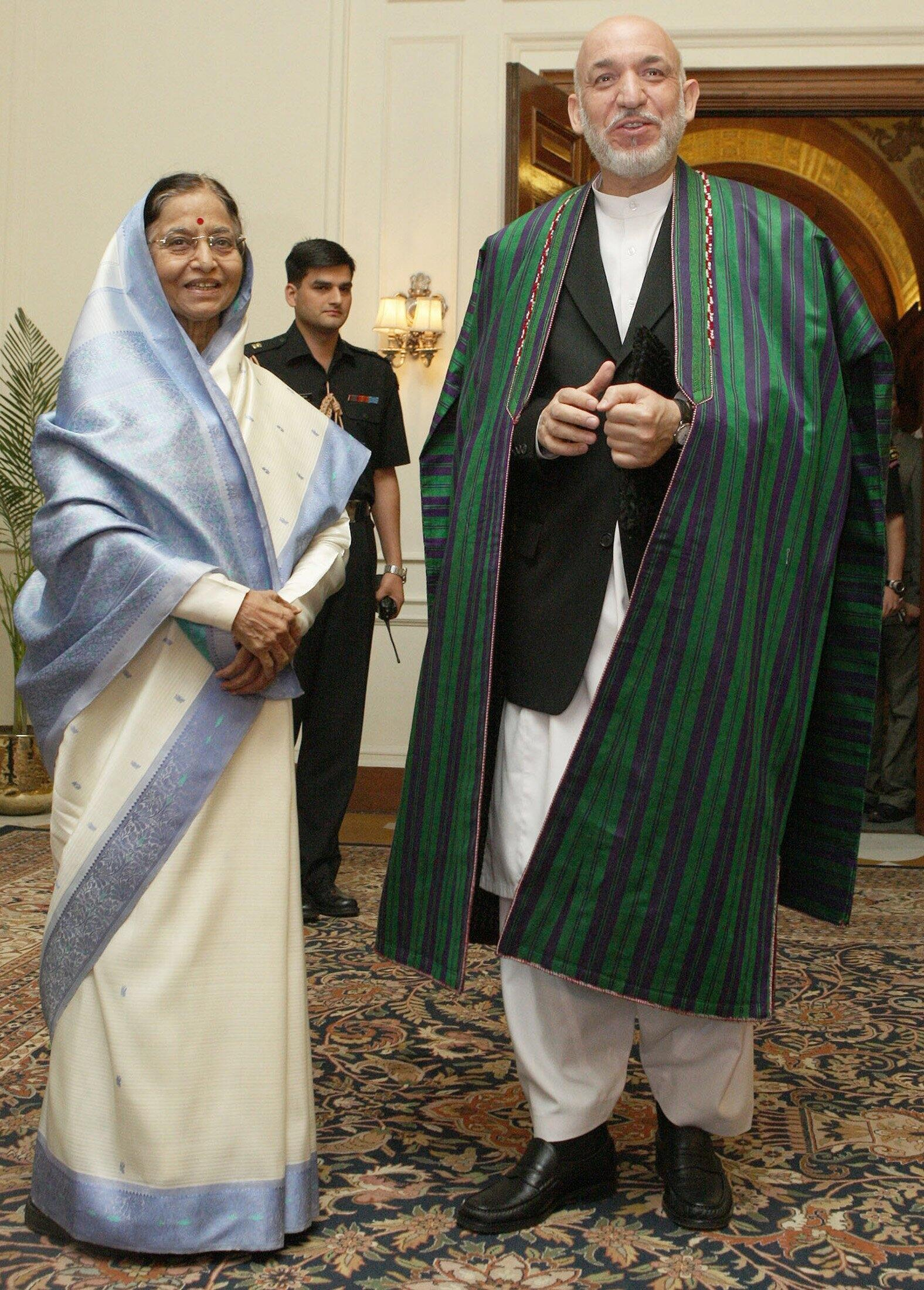 Indian President Patil and her Afghanistan's counterpart Karzai smile in New Delhi
