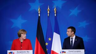 德国总理默克尔与法国总统马克龙联合举行新闻发布会