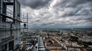 A man works at the construction site of the tower Silex 2 in Lyon, France