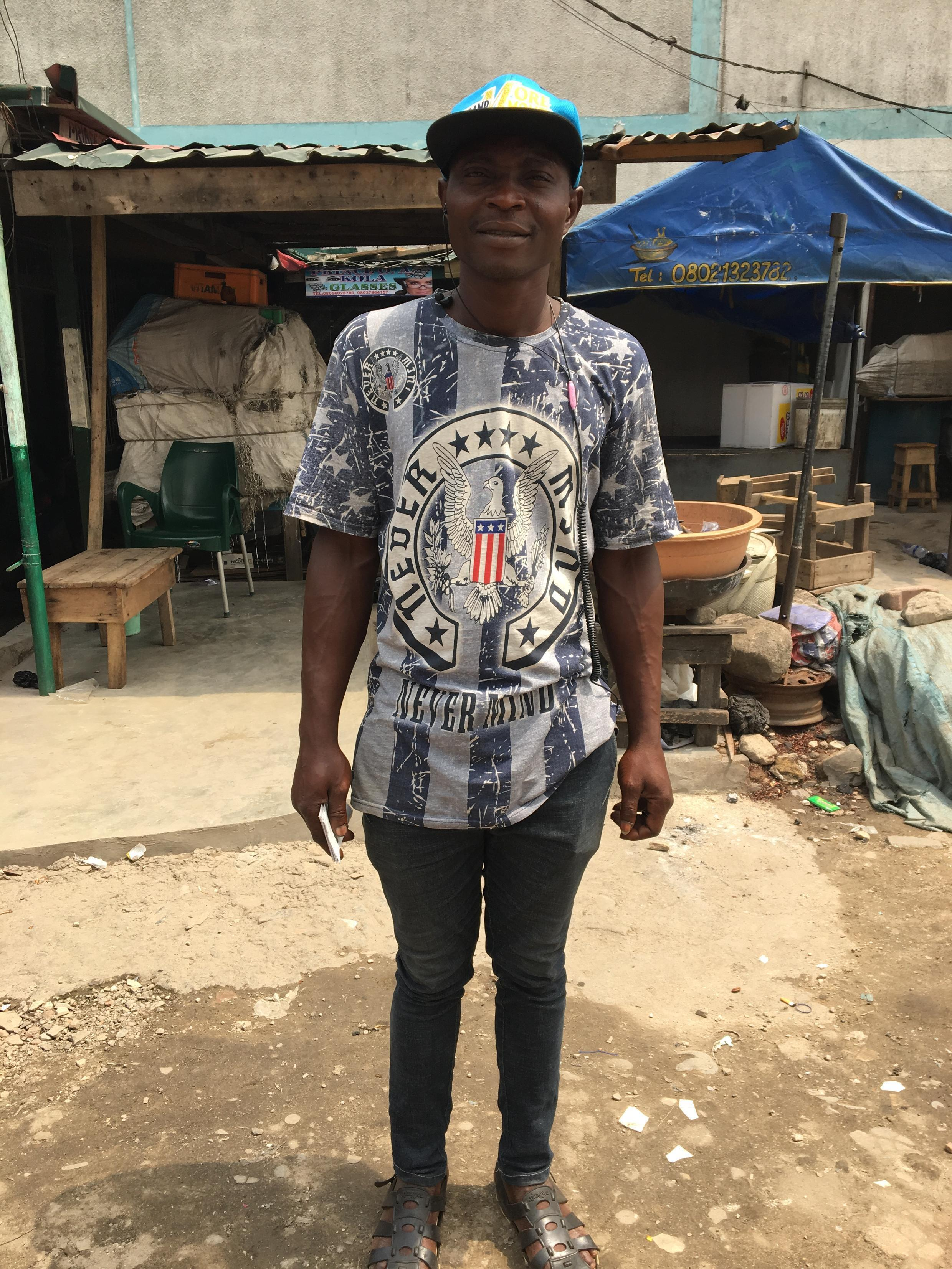 Fadipe works the car park in the Lagos market on Lagos Island, February 16th, 2019