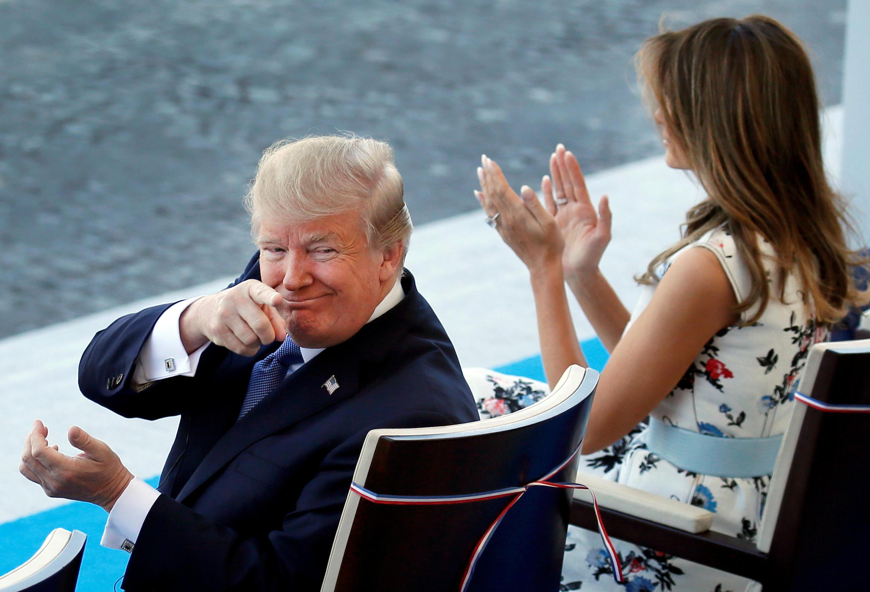 图为美国总统特朗普与夫人梅兰妮应邀出席法国国庆阅兵仪式