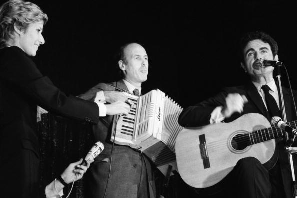 Daniele Gilbert Hands The Microphone To Valery Giscard D'Estaing, Then The Minister Of Economy And Finance As He Plays The Accordeon Beside Guy Beart, On The Guitar, During The Gala Given At The Congress Of Independent Republicans In Toulouse On October 11, 1971.