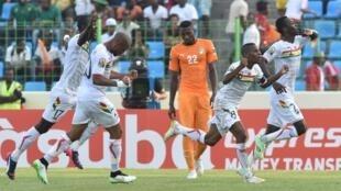 Guinea's team celebrate a goal against Côte d'Ivoire.