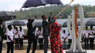 Rwandan President Paul Kagame lights the flame at the genocide memorial in Kigali in April 2015.