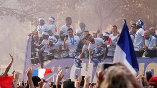 France's Olivier Giroud, Hugo Lloris and team mates on the bus during the World Cup victory parade