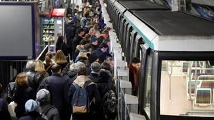 Paris-region commuters wait to board a train at the Chateau de Vincennes metro station as a strike against government plans to reform the pension system entered its 33rd consecutive day on Monday, 6 January 2020.