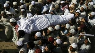 The funeral on Thursday of Mohammad Amin, killed by unidentified gunmen in Karachi the day before
