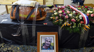 The backpack and walking stick of French mountaineer Hervé Gourdel sits on his coffin before it was flown to Paris, in this picture taken on January 26, 2015