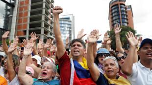 圖為委內瑞拉反對派2019年1月23日在加拉加斯示威